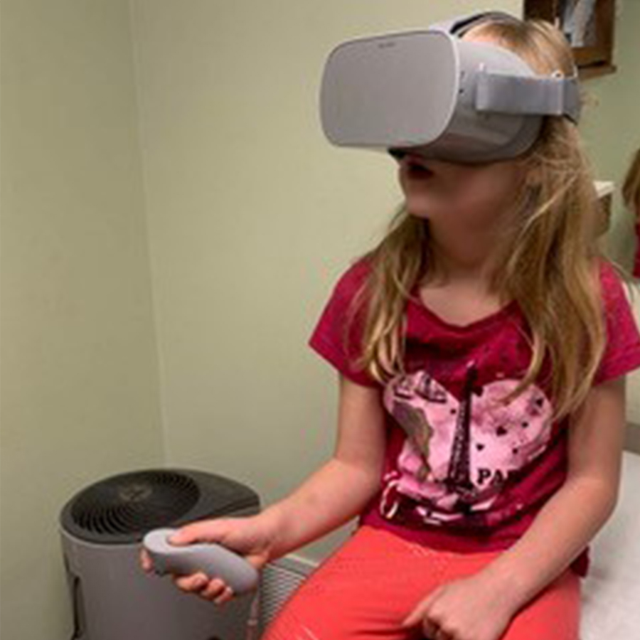 Young girl with VR headset on.